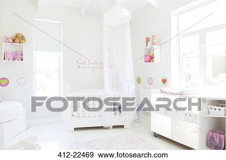 Stock Photograph White Crib With Tulle Canopy In Pastel Colored Baby S Room Fotosearch