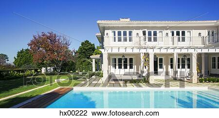 Swimming pool outside luxury house Stock Image