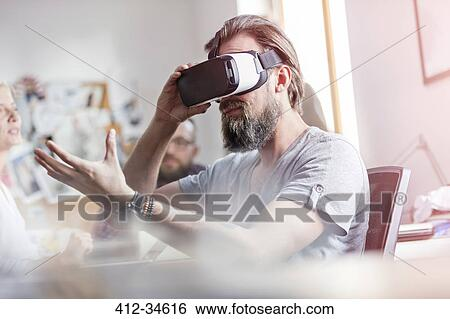 25fa0557738 Male design professional using virtual reality simulator glasses in office