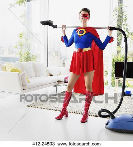 Stock Photo Of Superhero Holding Vacuum In Living Room 412 24503