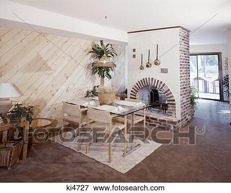 1970 1970S Dining Room Table Chairs Brick Fireplace Beige Carpet Area Rug  Baskets Home Decor Furniture Retro Stock Photo