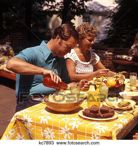 Stock Photo Of 1970 1970s Man Woman Backyard Picnic Table
