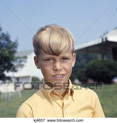 Picture Of Juvenile Boy Standing Outside Head Shot Dirty Blonde Hair