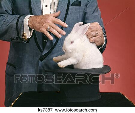 cecaa7714c2 Picture of Man Magician Pulling Rabbit Out Of Hat ks7387 - Search ...