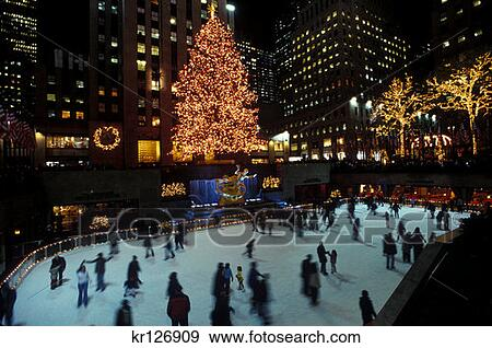 New York Christmas Time.New York New York People Ice Skating In Rockefeller Center At Christmas Time Stock Photo