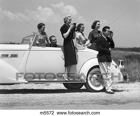 Stock Image - 1940 1940S Retro Camera Tourists Car Men Women . Fotosearch