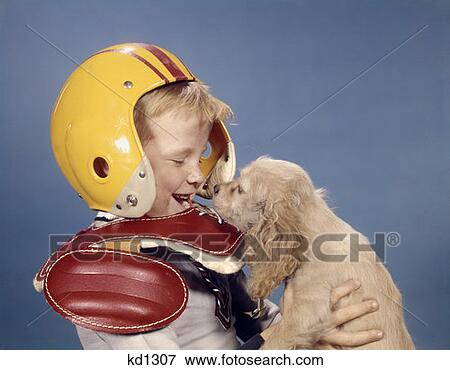 Picture Of 1960 S Laughing Little Boy Wearing Football Helmet And