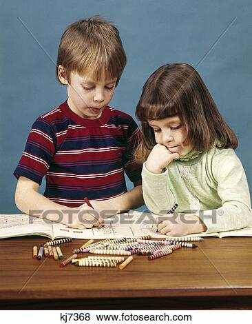 1970s Boy Girl Brother Sister Coloring Drawing In Books With Crayons