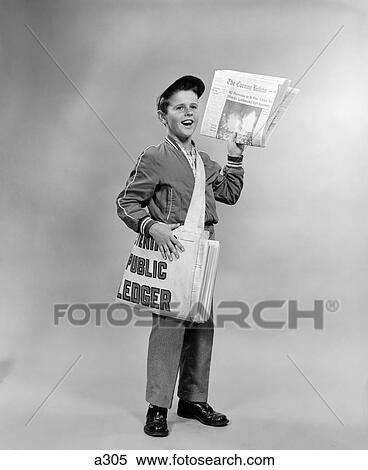 stock image of 1950s shouting newsboy standing selling