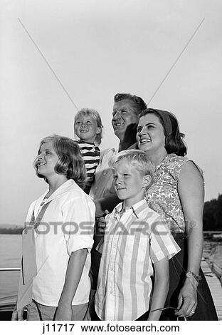 653e4fe2f 1960S Smiling Family Portrait Father Mother Two Daughters Son Standing  Together Outdoors
