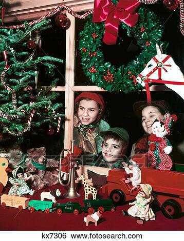 1960S Three Children Looking In Christmas Toy Store Window