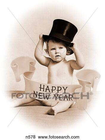 1930s baby wearing top hat surrounded by happy new year banner looking at camera