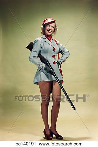 fb26e94cdcc 1940S 1950S Portrait Smiling Blond Woman Pinup Wearing Hunting Outfit  Holding Shotgun Looking At Camera