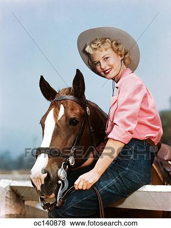 91fc2c704a22 Stock Photo - 1940S 1950S Smiling Blond Teen Girl Wearing Western Cowgirl  Outfit Sitting On Fence