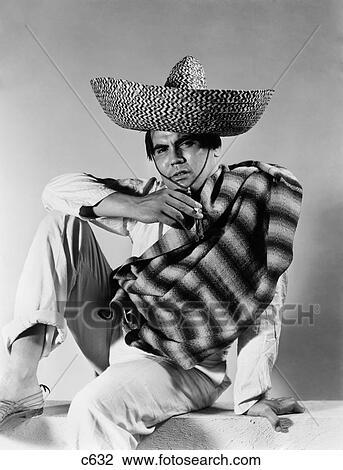 1930S 1940S Stereotype Portrait Mexican Man Wearing Striped Serape Sombrero  Hat Smoking Cigarette b448b4f392c