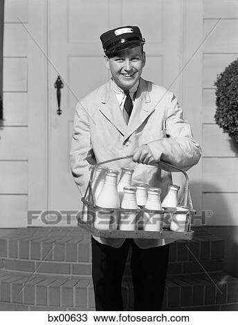 Stock Photo Of 1930s Smiling Milkman Looking At Camera