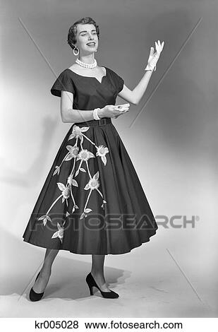 d489bc124 1950S Brunette Woman Wearing Black Dress With Flowers Gloves Pearl Choker  Stock Photo
