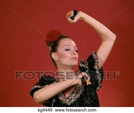 1970s Woman Dressed As Spanish Flamenco Dancer With Castanets Stock Photo Kg4449 Fotosearch