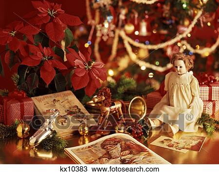 Stock Photo Of Antique Toys Poinsettia Under Christmas Tree Kx10383
