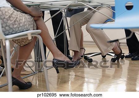 Businesswomen View Under Table