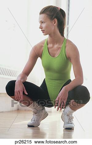 stock image of woman kneeling in exercise outfit pr26215 search