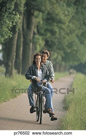 stock photo of couple riding on bike portrait pr76502 search