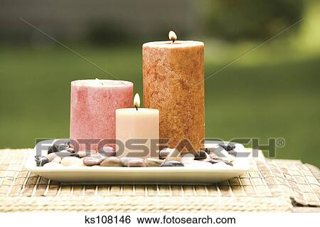 stock images of candles on plate with stones ks108146 search stock