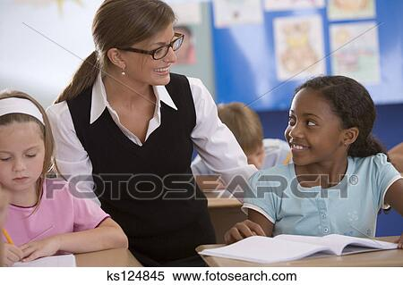 stock image of teacher talking to student ks124845 search stock