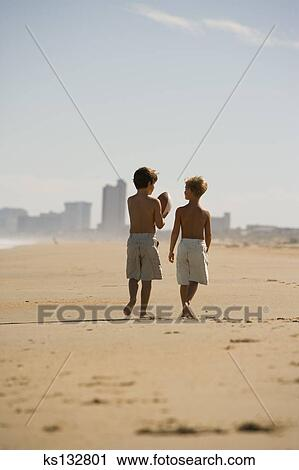 Boys Walking Along Beach