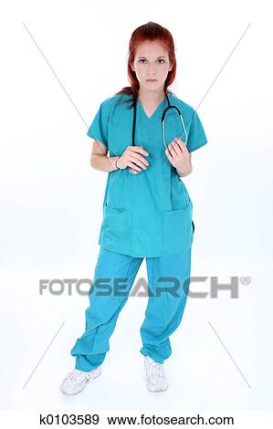 Tired Emergency Room Nurse Standing Over White Young Woman In Teal Scrubs With Stethoscope Shot Studio