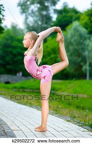 Stock Photo of flexible little girl doing gymnastics
