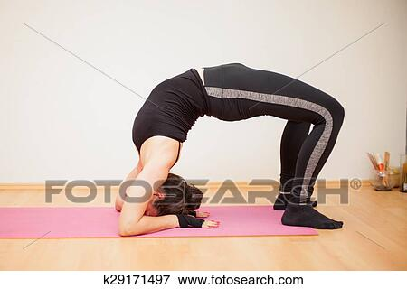 Practicing The Backbend Yoga Pose Stock Photo K29171497 Fotosearch