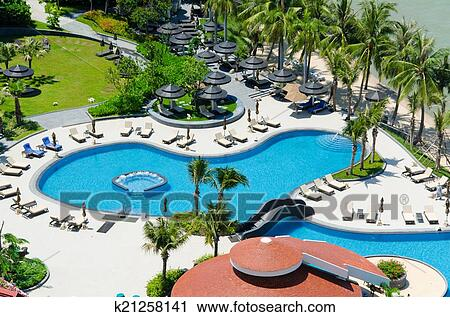 Top view of Swimming pools at tropical beach in luxury hotel ...