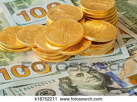 Stock Photography Gold Coins Stacked On New Design 100 Dollar Bills Fotosearch Search