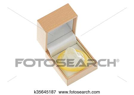 Picture Of A Beige Ring Box With New Unused Yellow Condom Inside