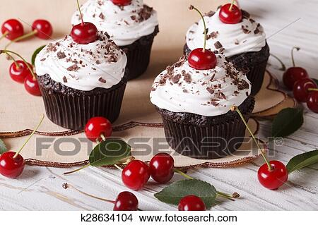 Stock Photo Of Beautiful Chocolate Cupcakes With White Cream And