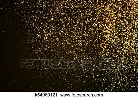 christmas gold sparkle glitter explosion dust particles background with bokeh gold holiday happy new year and valentine day concept