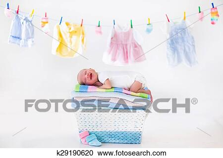 397dd6afdb9a Stock Photography of Newborn baby in a basket with towels k29190620 ...