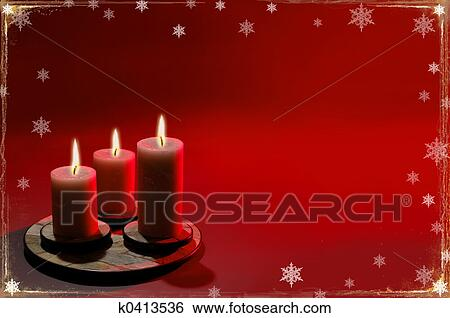 christmas background with candles and snowflakes over red background