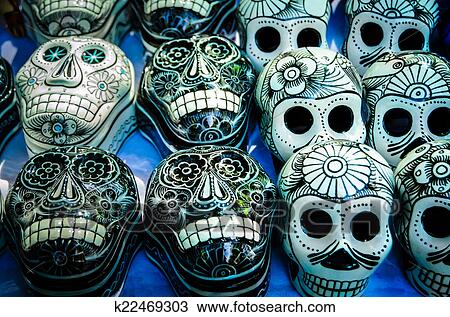 Traditional Mexican Day Of The Dead Souvenir Ceramic Skulls At Market Stall
