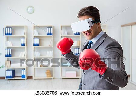984e093ca841 Stock Images of Man boxing in the office with virtual reality ...