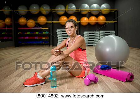 7b87d69ab A beautiful and strong female in pink clothes on a gym background. Fitness,  diet, sporty and people concept. Stock Image