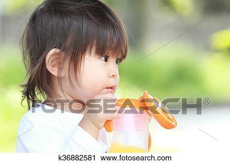 Japanese girl drinking water Stock Image
