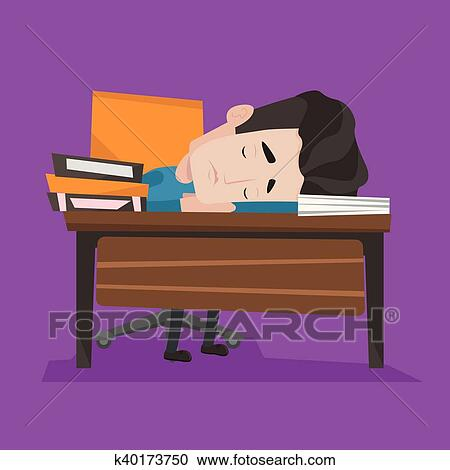 Sleeping student. A young student has fallen asleep at his desk.