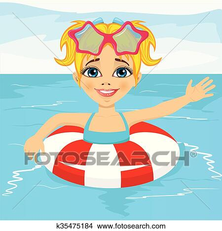 Cute little girl swimming in pool with inflatable ring ...  Little
