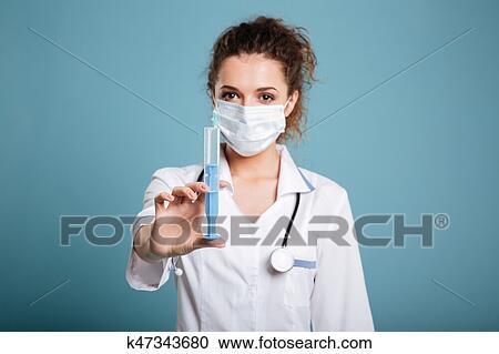 Young Female Doctor Or Nurse Holding Syringe , Isolated On