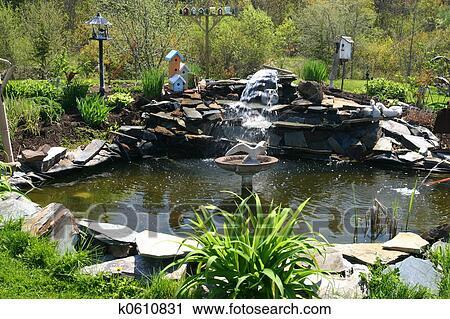 Archivio fotografico giardino acqua stagno k0610831 for Stagno giardino