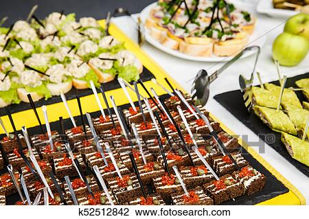 Tartlets, bruschetta or canapes on a tray in a restaurant with red caviar  Stock Image