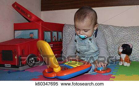 6 Months Old Baby Boy Playing With Toys Stock Image