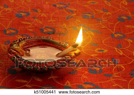 Stock Photography of Indian Festival Diwali Diya Lamp Light ... on diwali clip art, diwali pooja, diwali in dipa, diwali lanterns, diwali diva, diwali graphics, diwali lakshmi, diwali gods, diwali goddess coloring page, diwali decoration ideas, diwali celebration india, diwali festival, diwali lights, diwali aarti thali decoration, diwali celebrations in trinidad and tobago, diwali to learn words, diwali rangoli, diwali animated, diwali fireworks, diwali greetings,